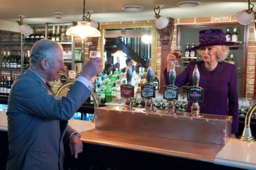 Cheers! Britain's Camilla, Duchess of Cornwall and Prince Charles, Prince of Wales enjoying a visit to a pub - pints may be hard to come by during the World Cup for England fans after a warning over a C02 shortage