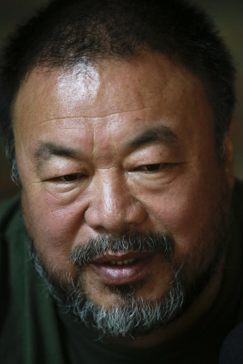 "Artist Ai Weiwei speaks to journalists at his studio in Beijing, China, Wednesday, May 22, 2013. Ai's music video accompanying his heavy metal single ""Dumbass'' released Wednesday depicts an insensitive, overbearing state power that tramples on individual rights. The video is meant to reconstruct his 81-day secret detention in 2011, which was part of the overall crackdown by Chinese authorities on dissent. Ai later was convicted of tax evasion, which his supporters saw as punishment for his activism. (AP Photo/Alexander F. Yuan)"