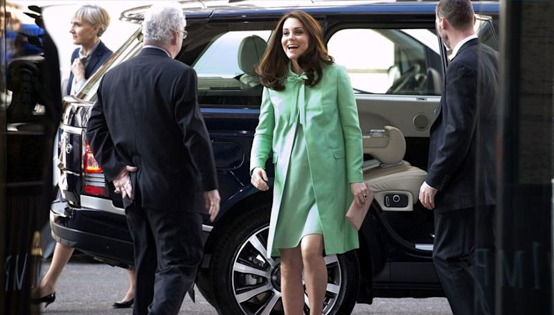 Kate Middleton steps out of car in london with lunchbox on car seat