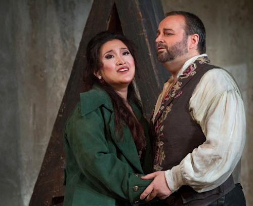 """In this photo Sept. 27, 2012 provided by the Metropolitan Opera, Guanqun Yu performs the role of Lenora and Gwyn Hughes-Jones performs the role of Manrico during a dress rehearsal of Verdi's """"Il Trovatore,"""" at the Metropolitan Opera in New York. (AP Photo/Metropolitan Opera, Marty Sohl)"""