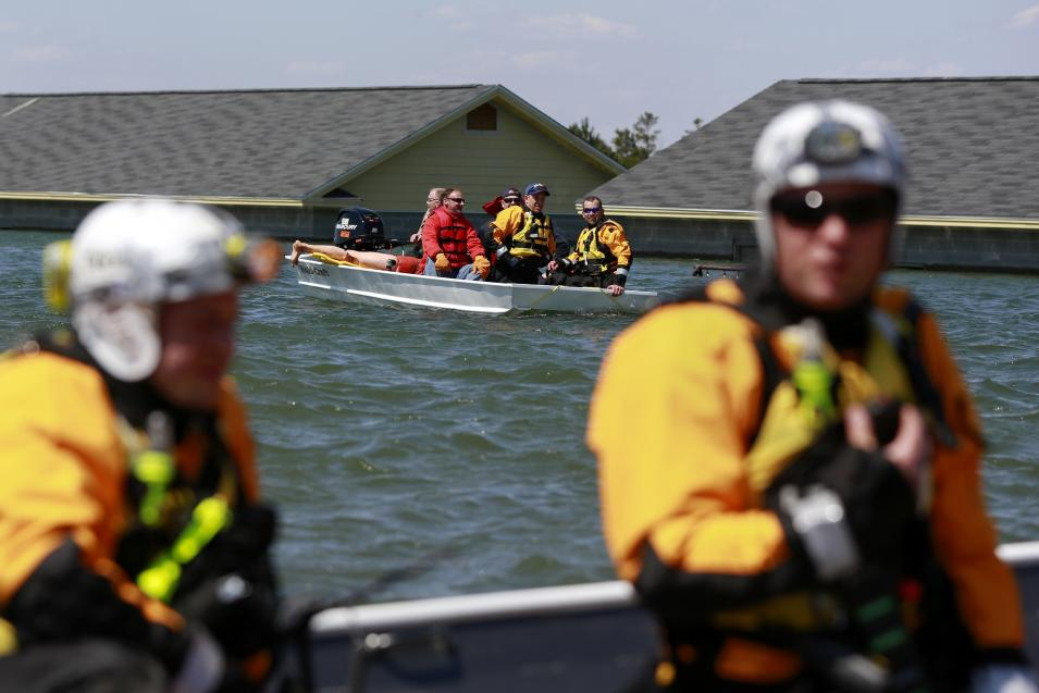 Rescue specialists for USA-1 rescue victims from the scene of a flooded mock disaster area during a training exercise at the Guardian Center in Perry