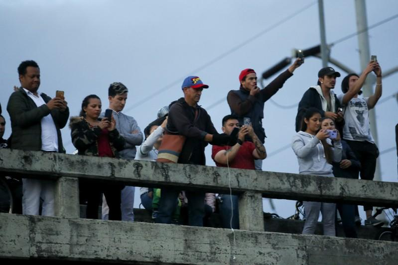 Demonstrators take part in a protest as a national strike continues in Bogota