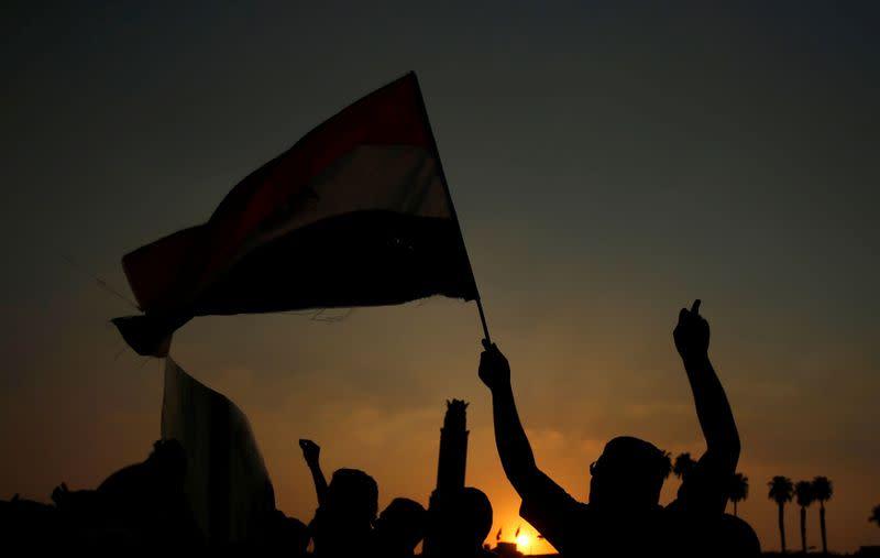 Egypt raids activist's family after US suit against former PM - lawyers