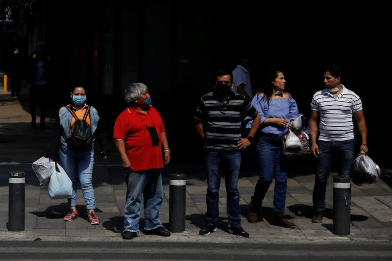 People are seen on the street as the government plans to start easing restrictions amid the outbreak of the coronavirus disease (COVID-19) in Mexico City