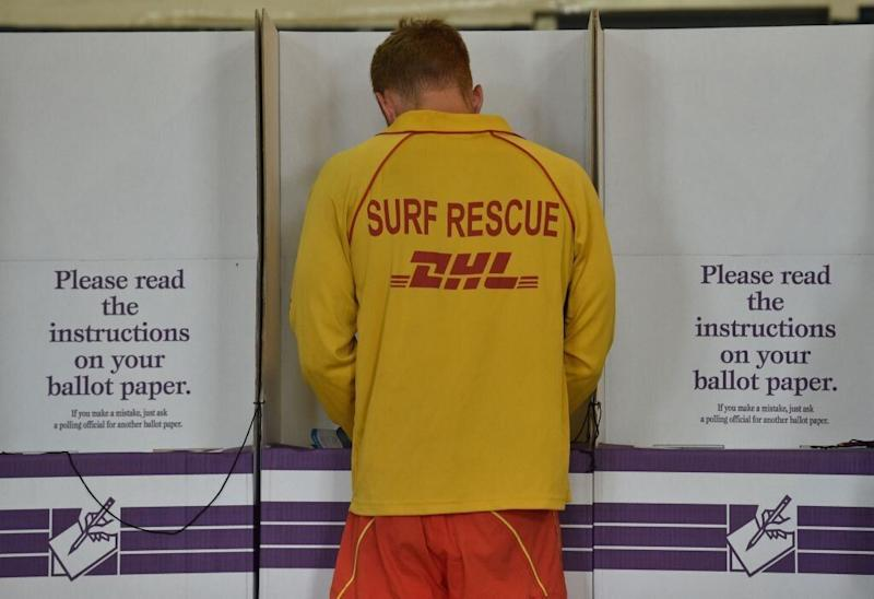 A surf lifesaver votes at a polling booth in the Australian Federal Election 2016. Source: Getty