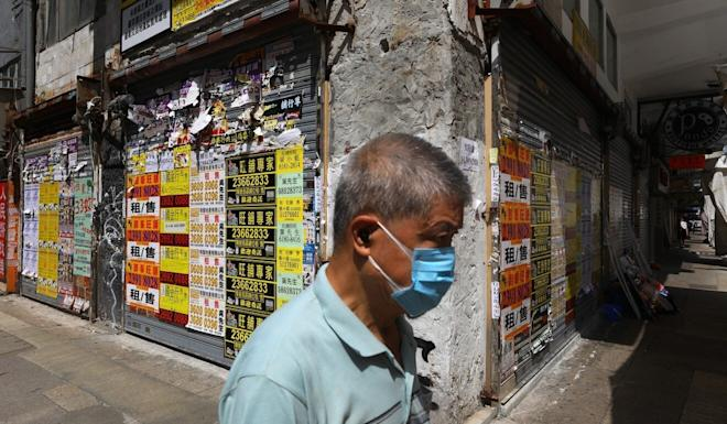 A man walks past an empty retail store space in Mong Kok last month amid a pandemic-related economic downturn. Photo: Dickson Lee