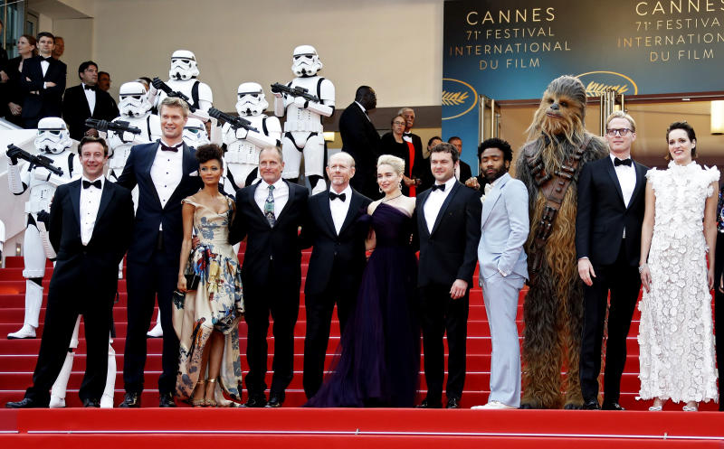 """71st Cannes Film Festival - Screening of the film """"Solo: A Star Wars Story"""" out of competition - Red Carpet Arrivals - Cannes, France May 15, 2018. Producer Simon Emanuel and director Ron Howard pose with cast members Joonas Suotamo, Thandie Newton, Chewbacca character, Woody Harrelson, Emilia Clarke, Phoebe Waller-Bridge and Alden Ehrenreich. REUTERS/Eric Gaillard"""