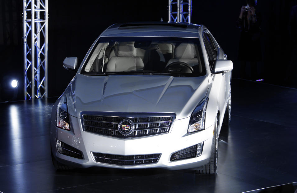 The 2013 Cadillac ATS makes its debut prior to the North American International Auto Show in Detroit, Sunday, Jan. 8, 2012. (AP Photo/Paul Sancya)