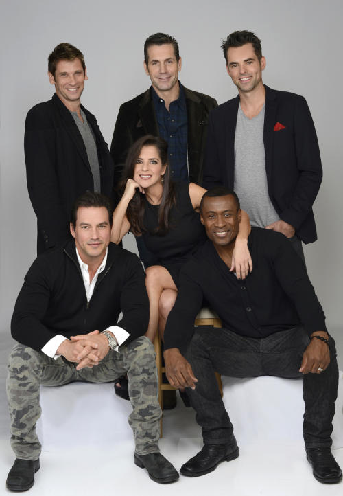 "This Oct. 24, 2013 photo released by ABC shows ""General Hospital"" actors Kelly Monaco, center, with, clockwise from front row left, Tyler Christopher, Roger Howarth, Executive Producer Frank Valenti, Jason Thompson and Sean Blakemore in New York. The popular daytime drama celebrates it's 50th anniversary this year. (AP Photo/ABC, Ida Mae Astute)"