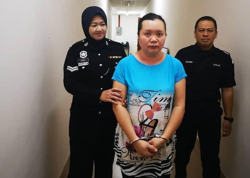 Chai Hui Sya is led out of the Magistrate's Court after the sentences were handed down in Kuching March 19, 2019. — Picture courtesy of Commercial Crimes Investigation Department
