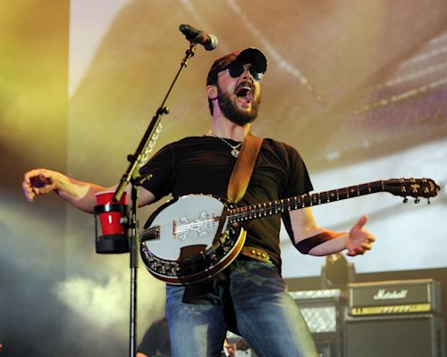 FILE - This April 14, 2013 file photo shows country singer Eric Church performing at the Tortuga Festival in Ft Lauderdale, Fla. Church, Luke Bryan and Miranda Lambert each received four nominations for the 2013 CMT Music Awards, on Monday, May 6. The awards show will air LIVE from the Bridgestone Arena in Nashville on Wednesday, June 5 at 8:00 p.m. EST. (Photo by Jeff Daly/Invision/AP, file)