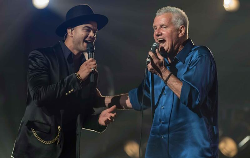 Daryl performing with Guy Sebastian. Source: Getty