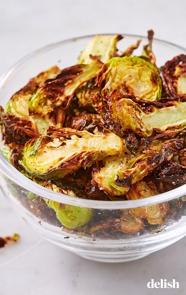"""<p>So much better than kale chips. </p><p>Get the recipe from <a href=""""https://www.delish.com/cooking/recipe-ideas/a19673558/best-brussels-sprout-chips-recipe/"""" target=""""_blank"""">Delish</a>.</p>"""