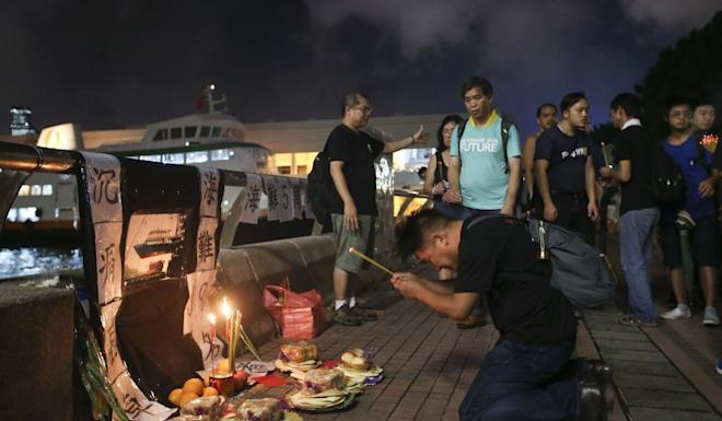 A vigil is held at the Central Ferry Piers on the fifth anniversary of the disaster. Photo: K. Y. Cheng