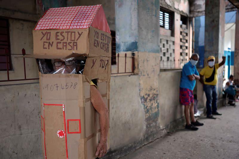 Cuban dons full-body cardboard shield against coronavirus