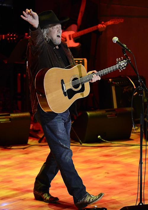 "John Anderson performs "" Marie Laveau"" during a music tribute to country music star Bobby Bare at the ceremony for the 2013 inductions into the Country Music Hall of Fame on Sunday, Oct. 27, 2013, in Nashville, Tenn. The inductees are Bobby Bare, the late ""Cowboy"" Jack Clement and Kenny Rogers. (AP Photo/Mark Zaleski)"