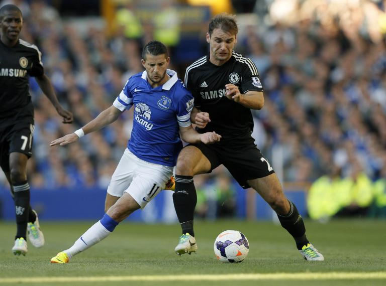 Chelsea's Ivanovic challenges Everton's Mirallas during their English Premier League soccer match in Liverpool