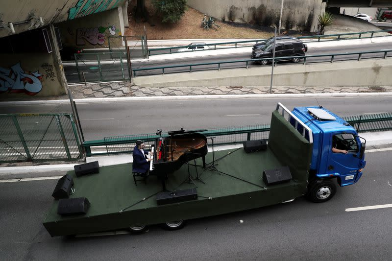 Pianist Rodrigo Cunha serenades from an open truck the lonely mothers in quarantine as the spread of the coronavirus disease (COVID-19) continues in Sao Paulo