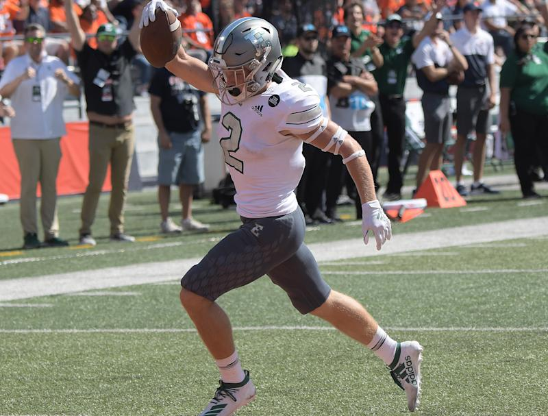 Mathew Sexton blocked a punt and returned it for a touchdown in the final seconds to send Eastern Michigan past Central Connecticut State on Saturday.