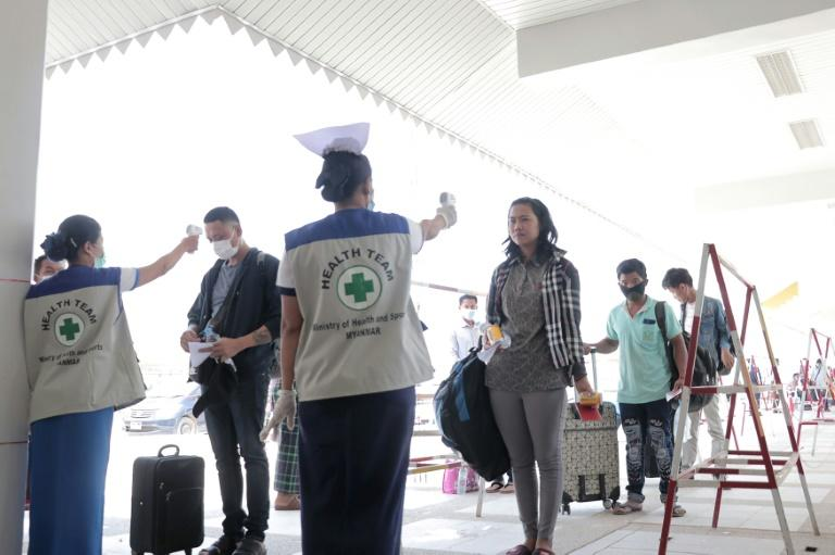 People entering Myanmar have their temperatures checked amid concerns over the spread of the COVID-19 coronavirus at the immigration post in Myawaddy, near the Thai border