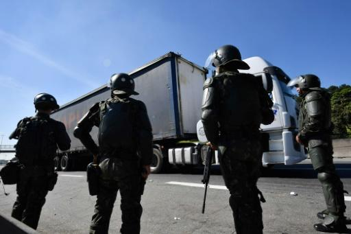 Soldiers take part in an operation to clear highway Regis Bittencourt, 30 km from Sao Paulo, as a truckers' strike against rising fuel costs in Brazil that has left much of the country paralyzed, is now over