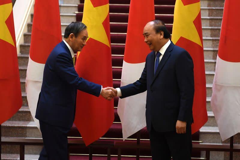 On Suga's overseas debut, Japan, Vietnam agree broadly on defence transfer