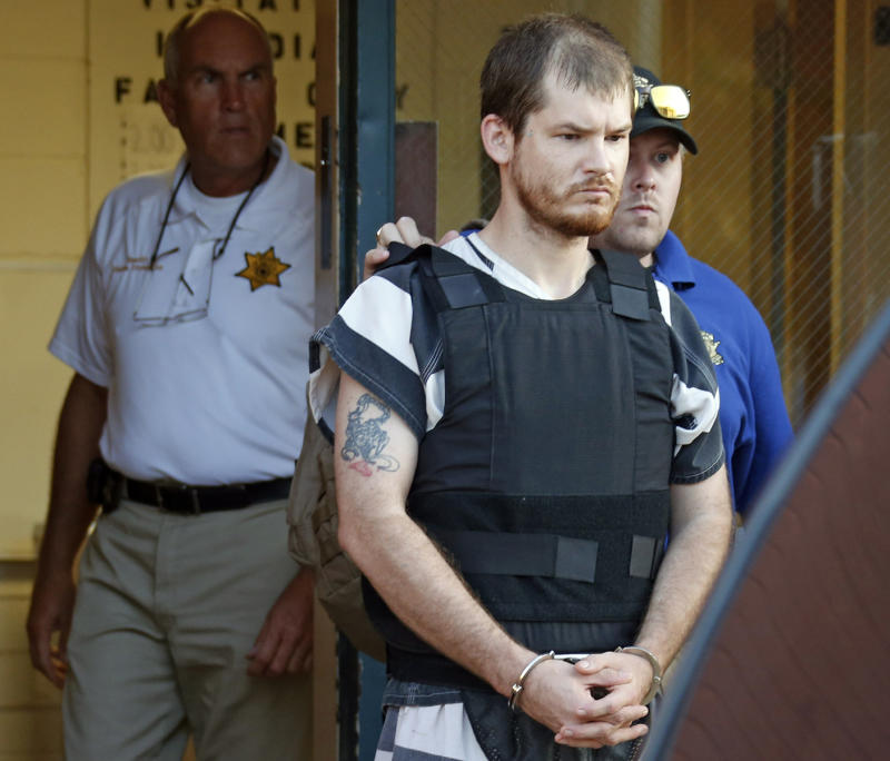Timothy Ray Jones Jr is escorted to prison after being accused of killing his five young children in their South Carolina home. Source: AP