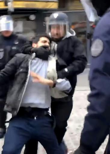The scandal erupted Wednesday when French daily Le Monde published a video taken by smartphone showing Benalla, wearing a riot police helmet and surrounded by officers, manhandling and striking a protester during a May 1 demonstration
