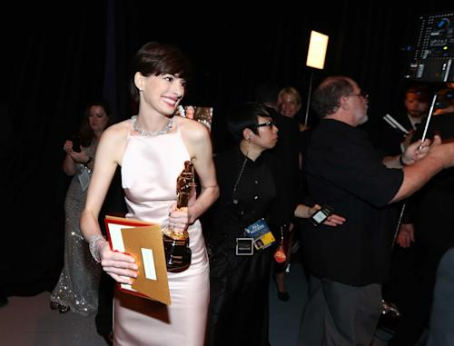 Anne Hathaway stands backstage with her award for best supporting actress at the Oscars at the Dolby Theatre on Sunday Feb. 24, 2013, in Los Angeles. (Photo by Matt Sayles/Invision/AP)