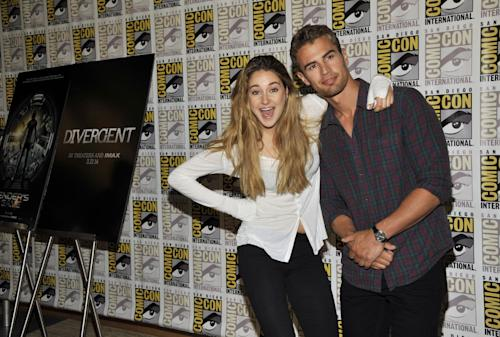 """Shailene Woodley, left, and Theo James attend the """"Divergent"""" press line on Day 2 of Comic-Con International on Thursday, July 18, 2013 in San Diego, Calif. (Photo by Chris Pizzello/Invision/AP)"""