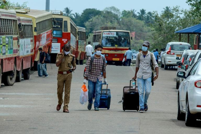 A navy ship carrying almost 700 evacuees arrived in India as part of a massive effort to bring home hundreds of thousands of nationals stranded overseas
