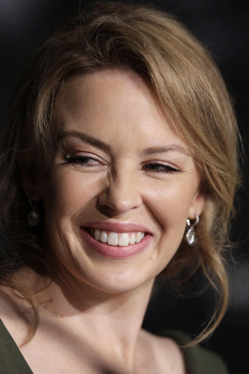 Actress Kylie Minogue smiles during a press conference for Holy Motors at the 65th international film festival, in Cannes, southern France, Wednesday, May 23, 2012. (AP Photo/Francois Mori)