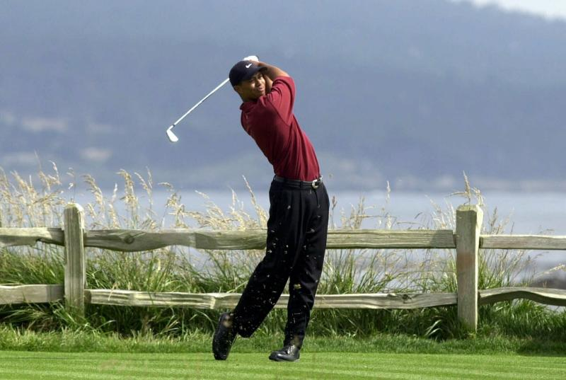 FILE - In this June 18, 2000, file photo, Tiger Woods tees off on the 18th hole on his way to winning the 100th U.S. Open Golf Championship at the Pebble Beach Golf Links in Pebble Beach, Calif. Golf Channel is airing a one-hour special on May 24 of Woods winning all four majors in a span of 10 months. (AP Photo/Elise Amendola, File)
