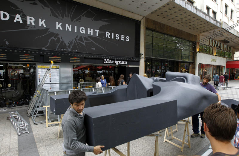 Studio puts 'The Dark Knight Rises' promotion on hold, screenings continue as planned