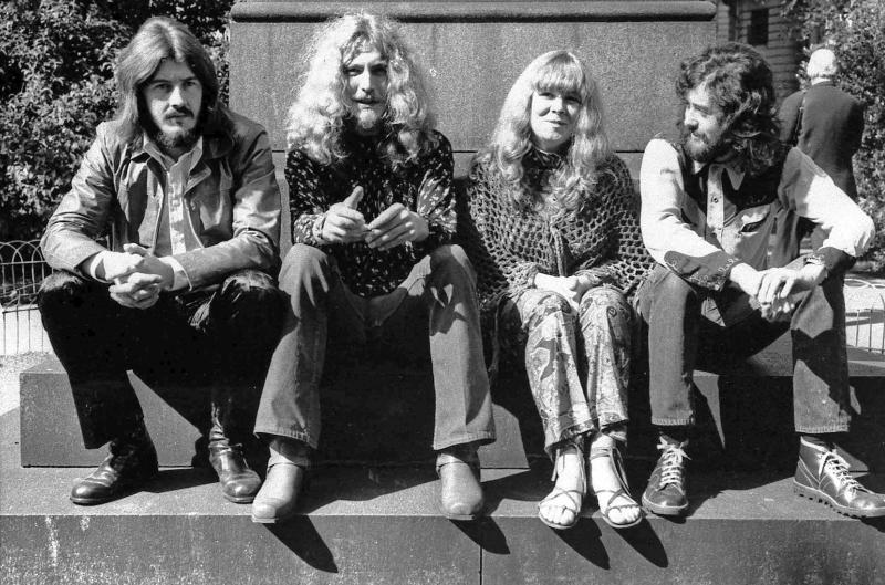"""FILE - In this September 1970 file photo, members of the rock group Led Zeppelin and singer Sandy Denny pose in London after receiving their awards in the Melody Maker Pop Poll in London. From left are John Bonham, Robert Plant, Denny and Jimmy Page. A federal appeals court on Monday, March 9, 2020, restored a jury verdict that found Led Zeppelin did not steal """"Stairway to Heaven."""" (AP Photo, File)"""