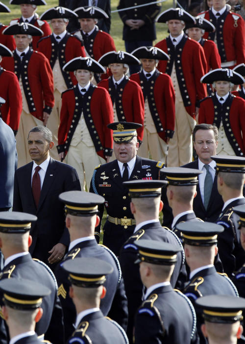 President Barack Obama and British Prime Minister David Cameron review the honor guard during an official arrival ceremony on the South Lawn of the White House in Washington, Wednesday, March 14, 2012. (AP Photo/Charles Dharapak)