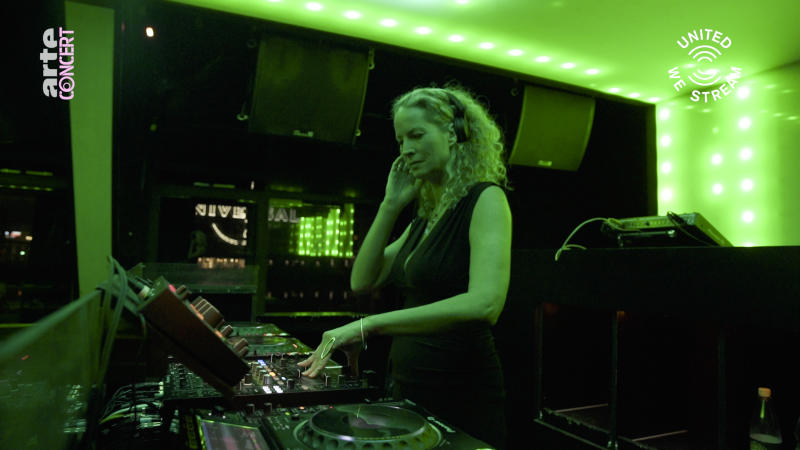"""In this March 18, 2020, frame from video provided by Rundfunk Berlin-Brandenburg, DJ Monika Kruse performs a set as part of the """"United We Stream"""" event at the club Watergate in Berlin. Berlin's nightclubs were closed March 13 to help slow the spread of the virus. In response, some of them formed a streaming platform to let DJs, musicians and artists continue performing. (Rundfunk Berlin-Brandenburg via AP)"""