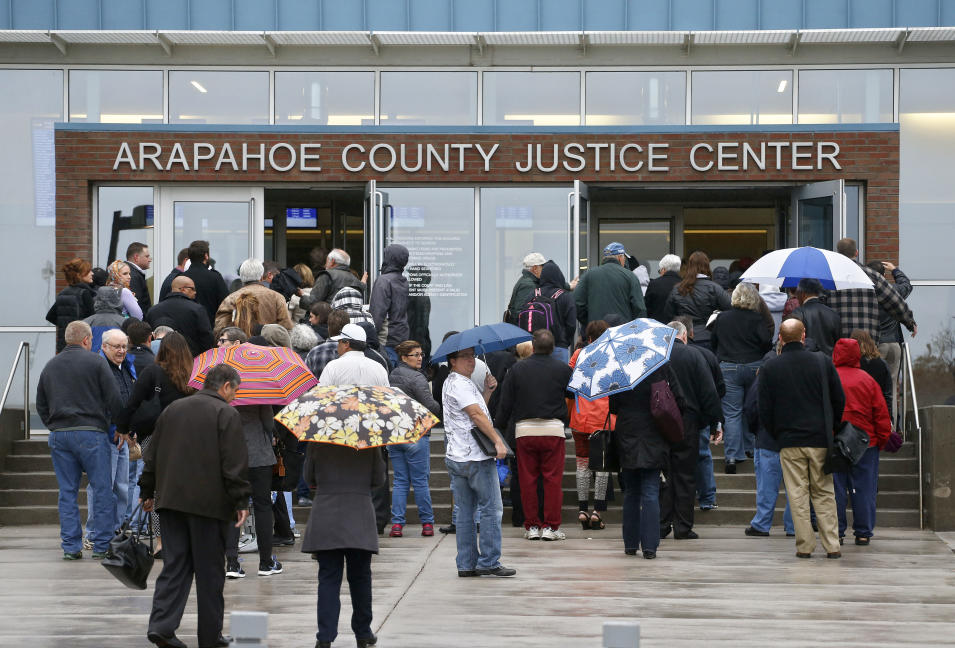 People enter the Arapahoe County Justice Center on the first day of the trial of Aurora movie theater shootings defendant James Holmes, in Centennial, Colo., Monday, April 27, 2015. As the trial begins, the key won't be whether he caused the carnage, but whether Holmes was sane at the time of the killings. (AP Photo/Brennan Linsley)
