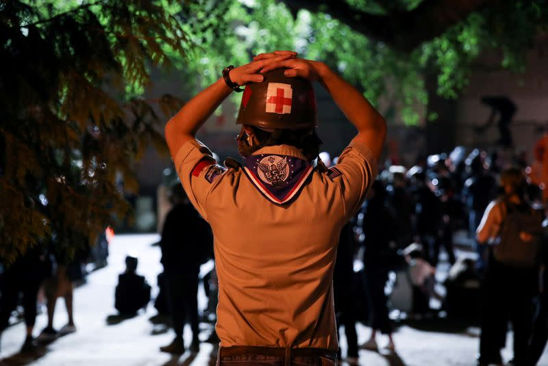 Portland protesters put out fires as feds withdraw