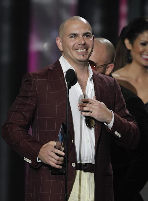 Pitbull smiles after accepting the award for the Song of the Year by a male performer during the Latin Billboard Awards in Coral Gables, Fla., Thursday April 26, 2012. (AP Photo/Lynne Sladky)