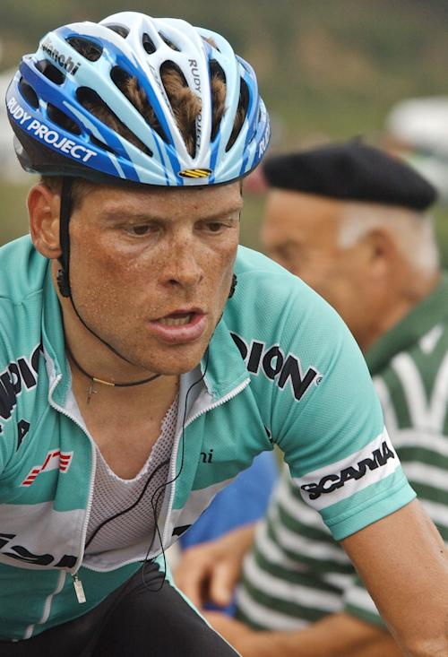 FILE - This is a Wednesday, July 23, 2003 file photo of Jan Ullrich of Germany as he strains in the ascent of the Bagarguy pass during the 16th stage of the Tour de France cycling race between Pau and Bayonne, southwestern France. The cyclists Lance Armstrong beat to win his seven Tour de France victories may soon get a chance at his titles. But their ranks include men who have faced a tangle of doping bans and accusations, possibly presenting a headache for Tour leadership. Ullrich finished second to Armstrong in 2003. (AP Photo/Peter Dejong, File)