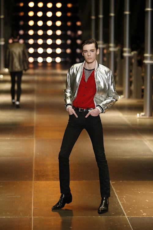 A model presents a creation as part of Yves Saint Laurent's men's fashion Spring-Summer 2014 collection, presented Sunday, June 30, 2013 in Paris. (AP Photo/Francois Mori)