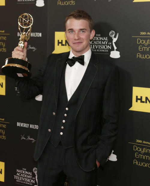 "Chandler Massey poses backstage with the award for outstanding younger actor in a drama series for ""Days of our Lives"" at the 39th Annual Daytime Emmy Awards at the Beverly Hilton Hotel on Saturday, June 23, 2012 in Beverly Hills, Calif. (Photo by Todd Williamson/Invision/AP)"