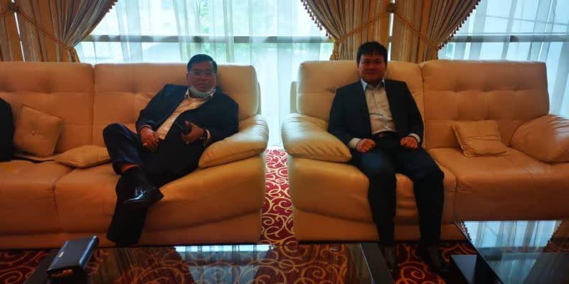 Lubok Antu MP Jugah Muyang (left) with Saratok MP Ali Biju at the Kuching International Airport this evening. — Picture courtesy of Vernon Kedit