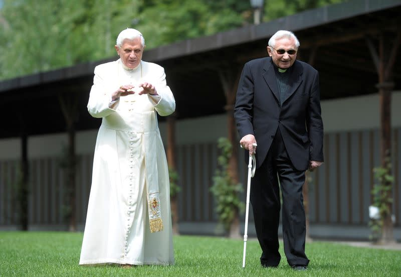 FILE PHOTO: Pope Benedict XVI strolls in a garden with his brother Bishop Ratzinger during his annual holiday in Bressanone