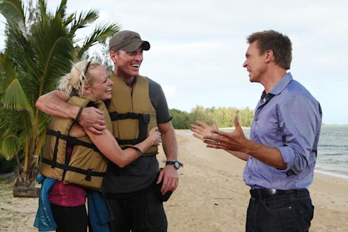"In this undated image released by CBS, Rachel and Dave Brown are shown with host Phil Keoghan, right, after winning on the latest edition of ""The Amazing Race,"" which aired Sunday, May 6, 2012 on CBS. The Madison, Wis., couple outlasted 10 other couples to win the $1 million grand prize. Dave Brown is in the Wisconsin Army National Guard and served in Iraq. He also teaches military science at the University of Wisconsin-Madison. Rachel Brown is a project manager for a software company. Because Dave has been deployed overseas, and Rachel frequently travels on business, they say one of the most rewarding parts of the competition was the chance to spend so much time together. (AP Photo/CBS, Monty Brinton)"