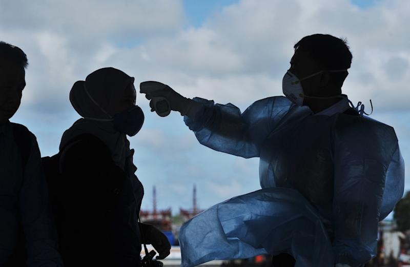 The ministry explained that a video showing a masked person dressed in the white protective suit leading a group of people into a beige-coloured van was part of its routine procedures. — Bernama pic