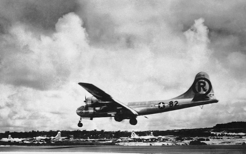 "The ""Enola Gay"" Boeing B-29 Superfortress lands at Tinian, Northern Mariana Islands, after the US atomic bombing mission - Japan Hiroshima Anniversary QA"