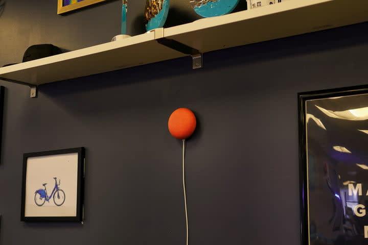 Google Nest Mini side angle on wall
