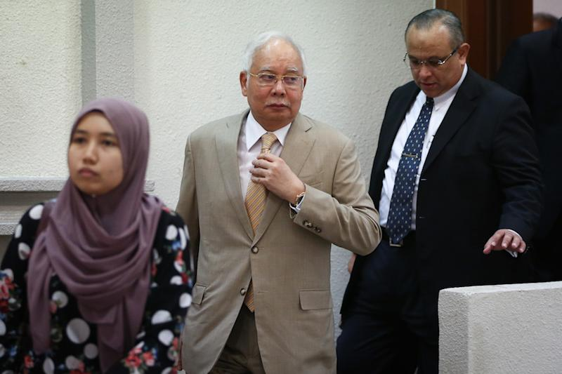 Former prime minister Datuk Seri Najib Razak leaves the courtroom for a short recess during his trial at the Kuala Lumpur High Court December 11, 2019. — Picture by Yusof Mat Isa